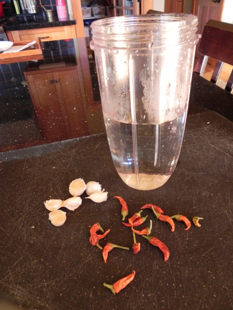 Peppers and garlic soak in water overnight.