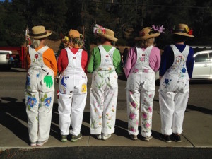 Cambria Garden Club members wear hand-painted coveralls.