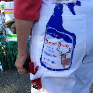 """Deer Away"" on hand-painted overalls."